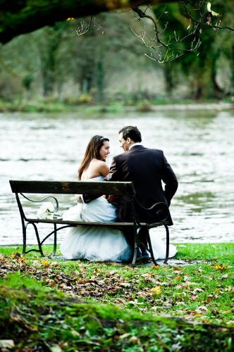 Wedding photograph of bride and groom by lake